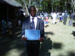 Ernest with his diploma at the end of the cememony.